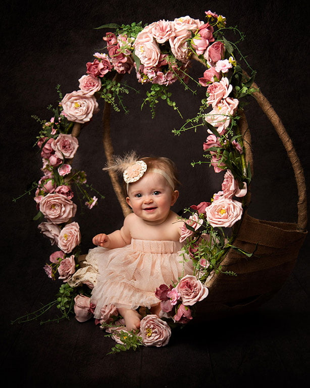 cute little girl in ring of flowers  baby photography Leeds Brds