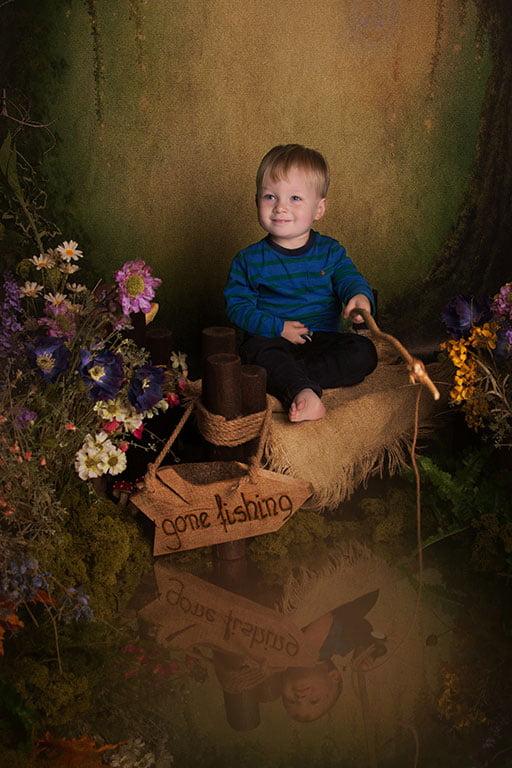 little boy fishing in child photoshoot in Bradford