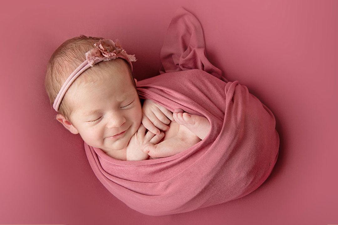 baby girl in pink by Newborn Photographer Bradford
