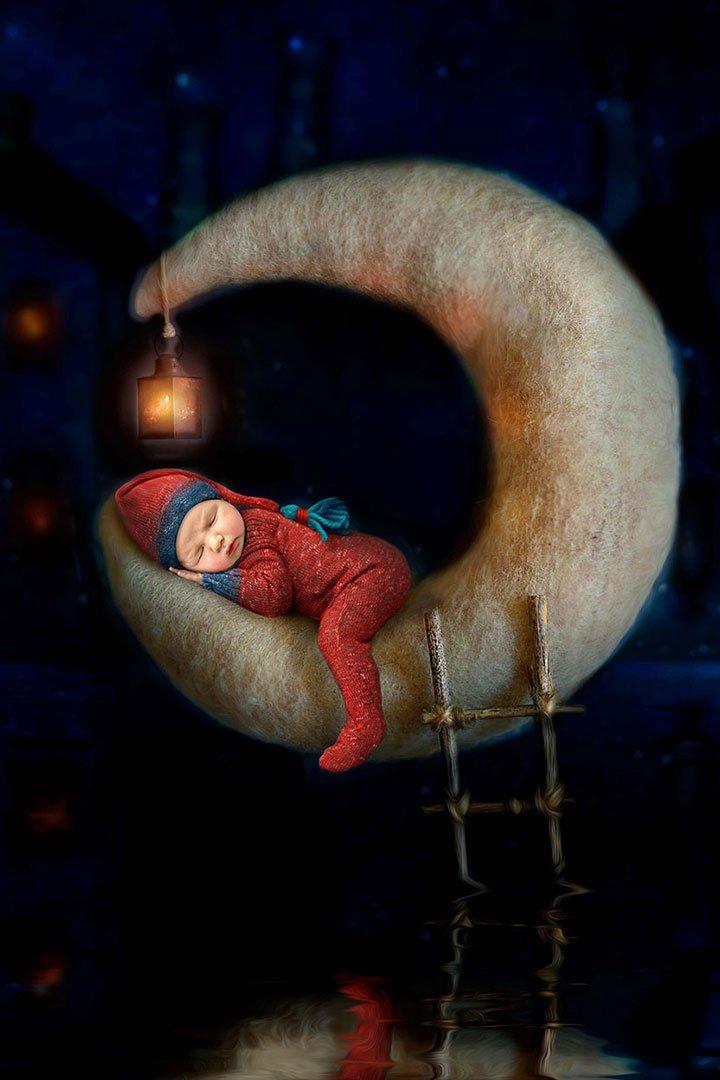 sleeping newborn baby on moon by Newborn Photographer Bradford created in photoshop