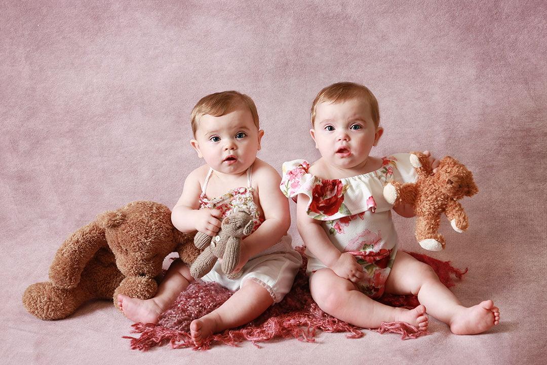 twin girls in pink for cakesmash Leeds