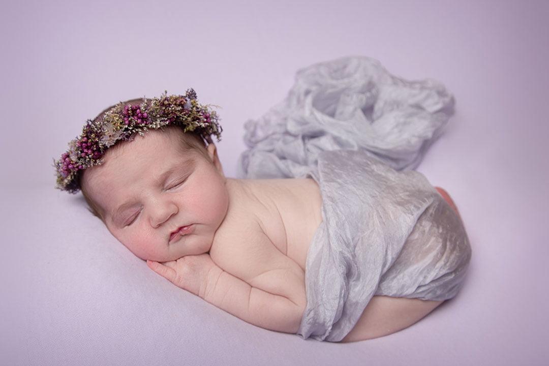 sleeping baby girl on pink by Newborn Photographer Bradford and leeds