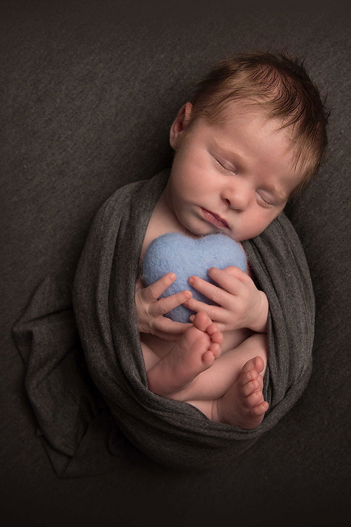 Newborn baby boy in a grey wrap by Newborn Photographer  inLeeds