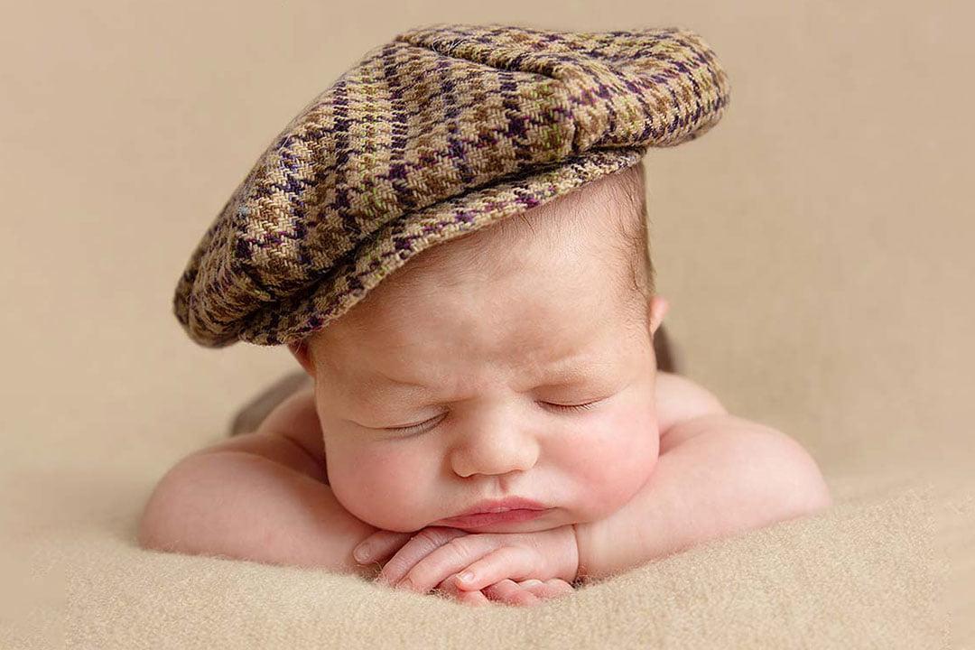 baby boy in tweed hat by Newborn Photographer Bradford