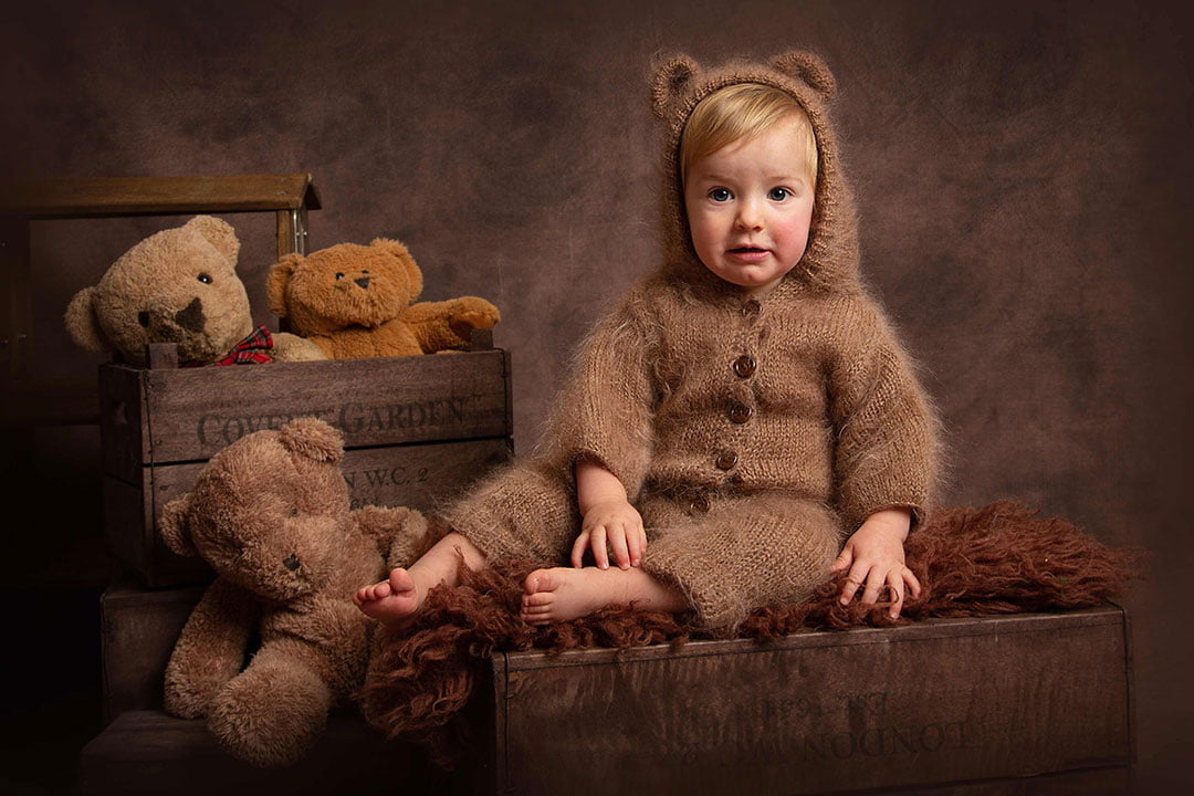 Older baby photoshoot with baby boy and bears by Newborn Photographer Leeds
