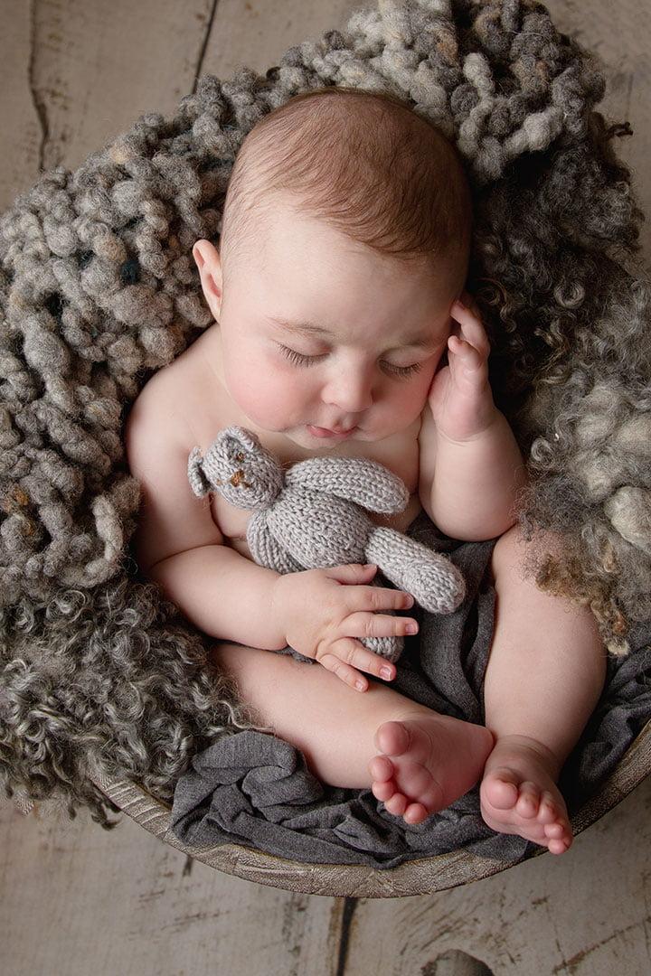 baby boy asleep in grey crocheted blanket image taken by Newborn Photographer Bradford