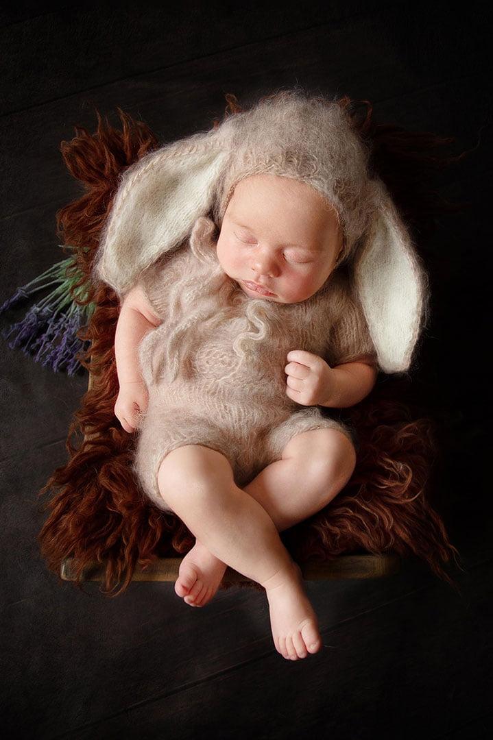 Newborn Photographer Bradford  takes baby boy in rabbit outfit