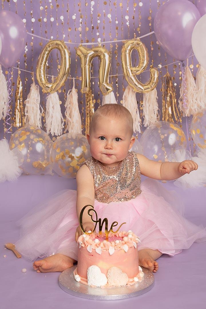 girl in pink dress having a photo taken by cakesmash photogrpaher Leeds